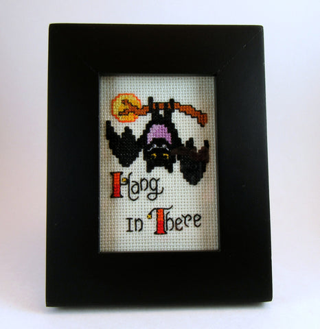 framed bat hang in there cross stitch