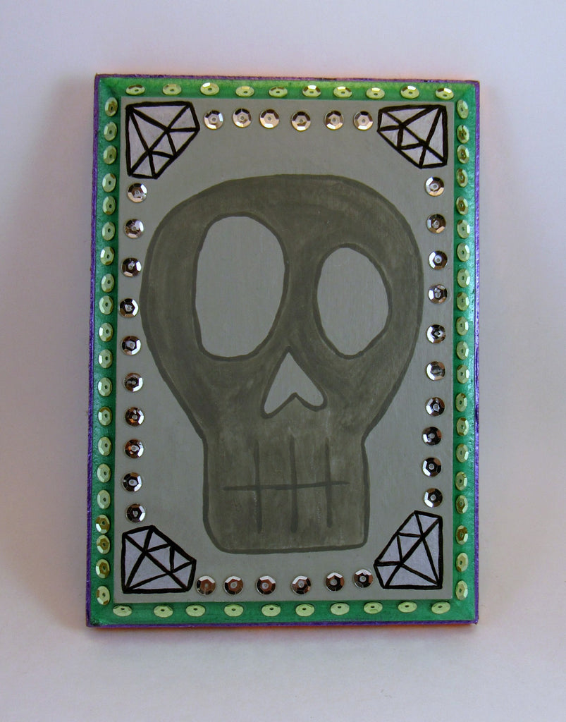 hand painted skull wall plaque