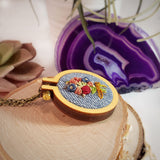 closeup hand embroidered floral pendant