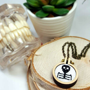 hand stitched black skeleton cameo pendant