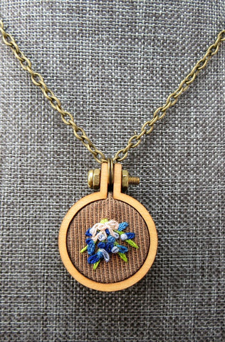 blue forget me not hand embroidered pendant