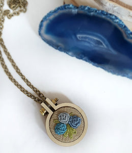 hand embroidered blue roses necklace