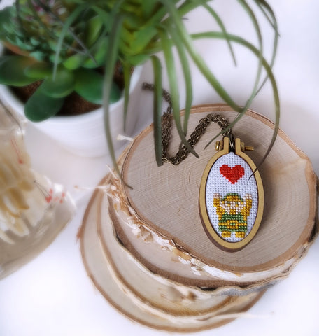 link heart container cross stitch necklace