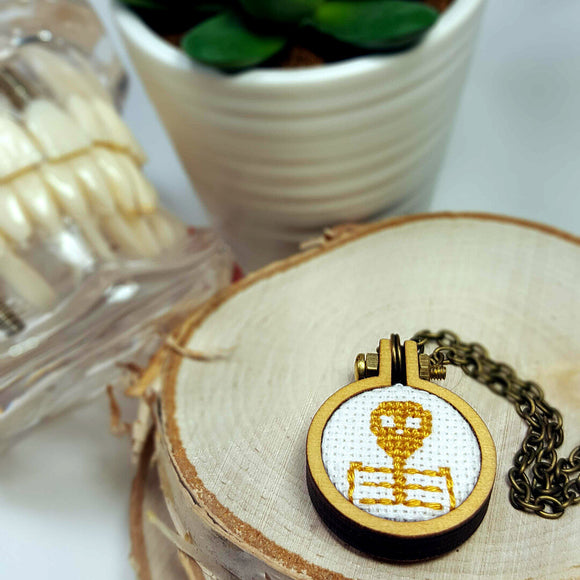 straw yellow cameo skeleton cross stitch necklace