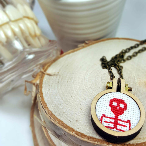 red cross stitched skeleton cameo necklace