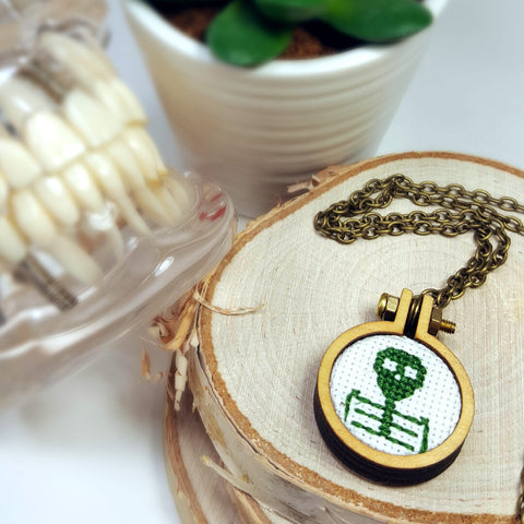 dark green cameo skeleton cross stitch necklace