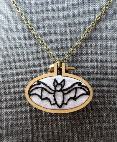 hand embroidered bat pendant