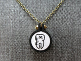 embroidered black tooth necklace