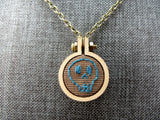teal skull necklace