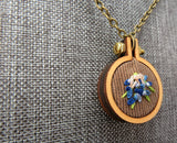 forget me not floral embroidered pendant