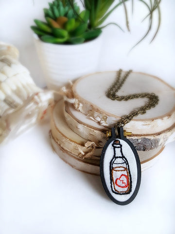 hand embroidered broken heart liquor bottle necklace