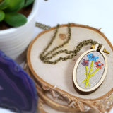 three hand embroidered daisies pendant