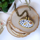 hand embroidered space pendant