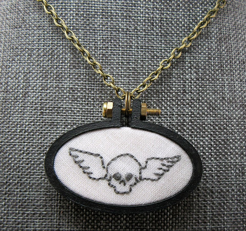 embroidered winged skull necklace.