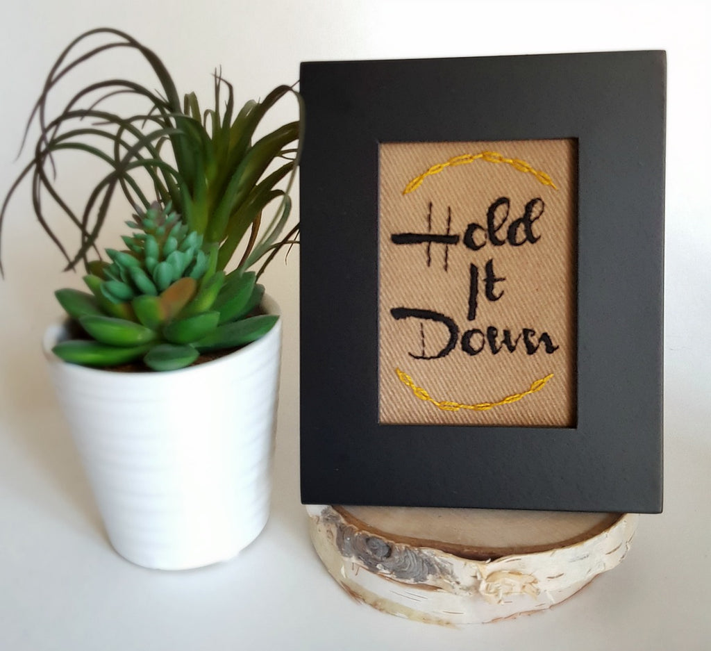 hold it down embroidered framed art