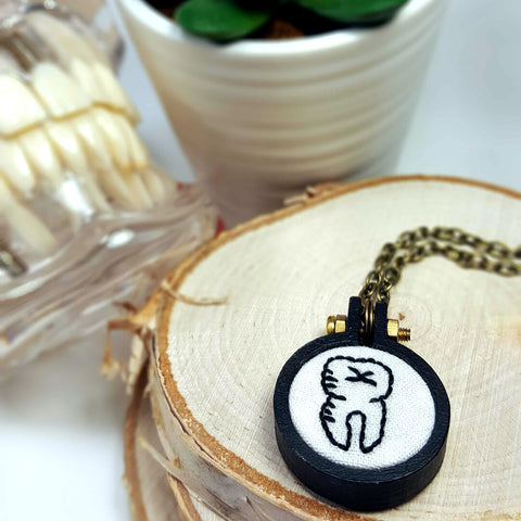 black tooth hand embroidered necklace