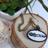 bejeweled hand embroidered dagger pendant