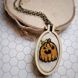 embroidered pumpkin pendant