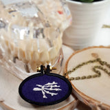 hand embroidered skeleton hand pendant