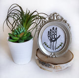 hand stitched skeleton hand silver frame