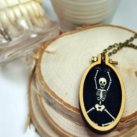 dancing skeleton wooden hoop necklace