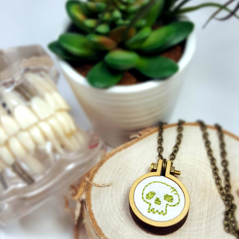 embroidered tiny lime skull necklace