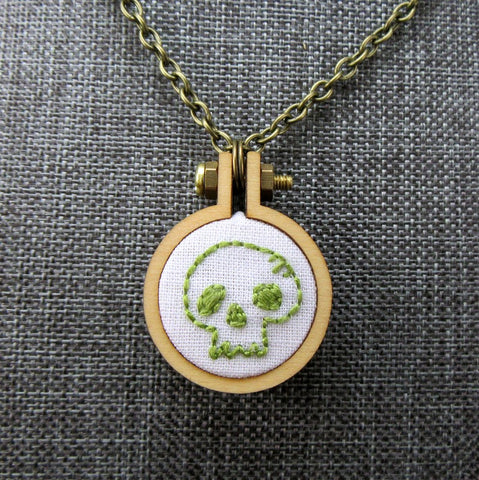 hand embroidered tiny lime skull necklace