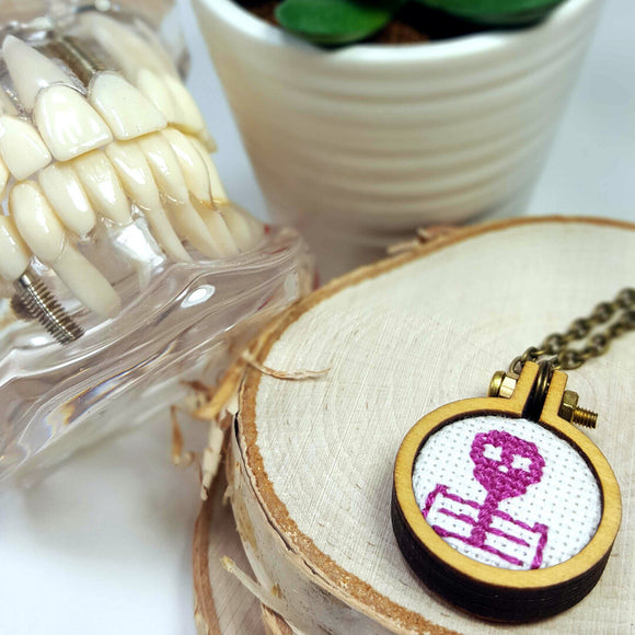 magenta cameo skeleton cross stitch necklace