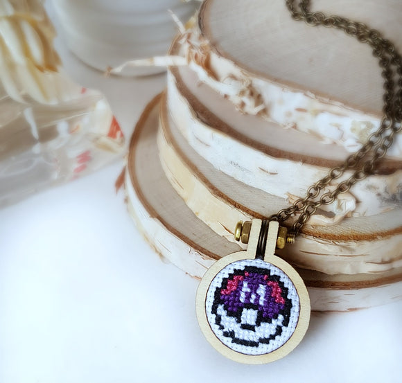 cross stitched masterball necklace