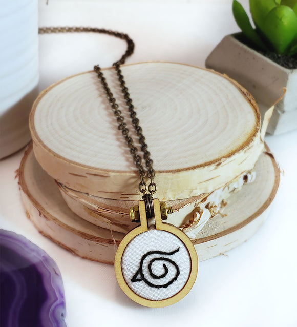 hand embroidered hidden leaf symbol necklace