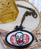 pennywise embroidered necklace