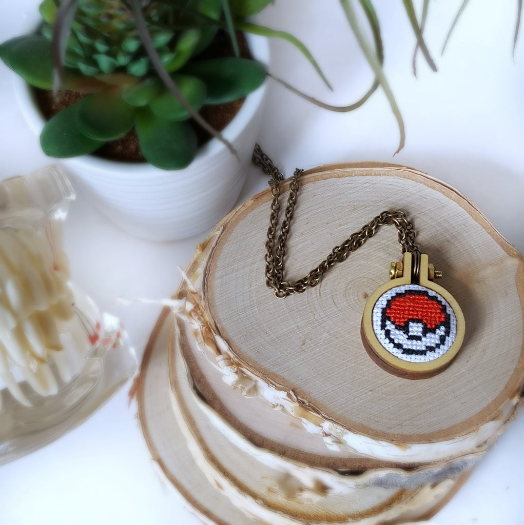 cross stitched pokeball necklace