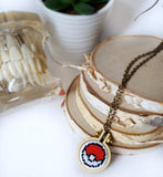 pokeball cross stitch necklace