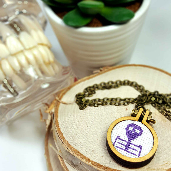purple cameo skeleton cross stitch necklace