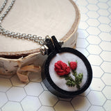 closeup red rose embroidered pendant
