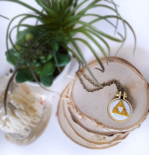 embroidered golden triforce necklace