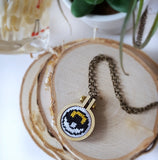 pokeball ultraball cross stitch necklace