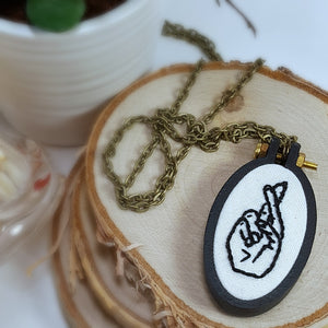 hand embroidered crossed fingers necklace
