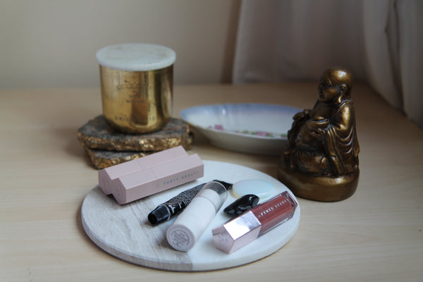 Selection of Beauty Products including Fenty, Glossier and Grown Alchemist