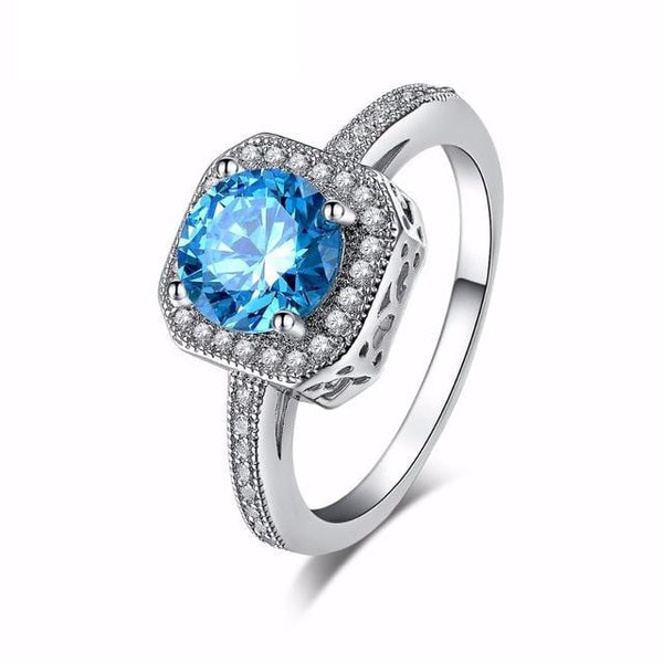 DH1YPI90 White Gold plated Round Blue CZ Ring