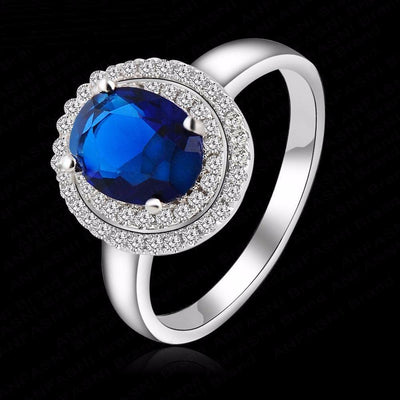 EABY9V5V Platinum Plated Round Blue CZ Ring
