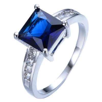 NI0MTHXT White Gold Filled Blue CZ Ring