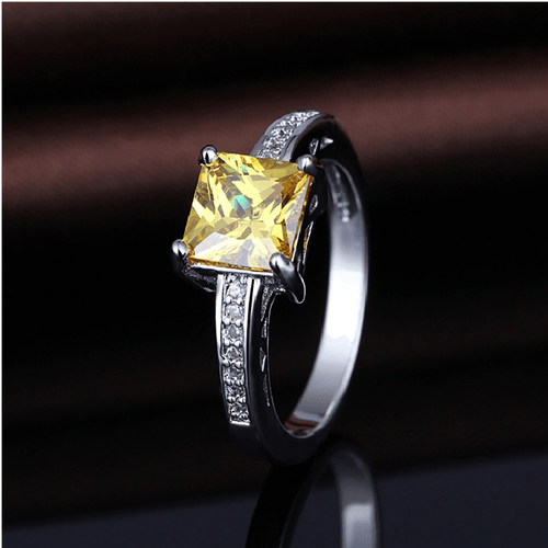 NRMM2W38 White Gold Plated Yellow CZ Ring