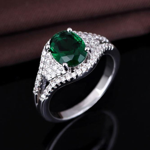 O05XQ17T 925 Sterling Silver Green AAA CZ Ring