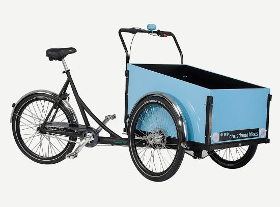 3 wheel Cargo bike/ trike with box and two wheels in front. Frame is black painted aluminum and marine plywood cargo box is painted with sky blue gloss enamel