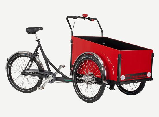 3 wheel Cargo bike/ trike with box and two wheels in front. Frame is black painted aluminum and marine plywood cargo box is painted with red gloss enamel