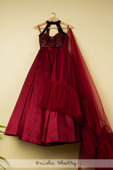 BURGUNDY LEHENGA WITH SEQUENCE HALTER BLOUSE AND FRILL DUPATTA