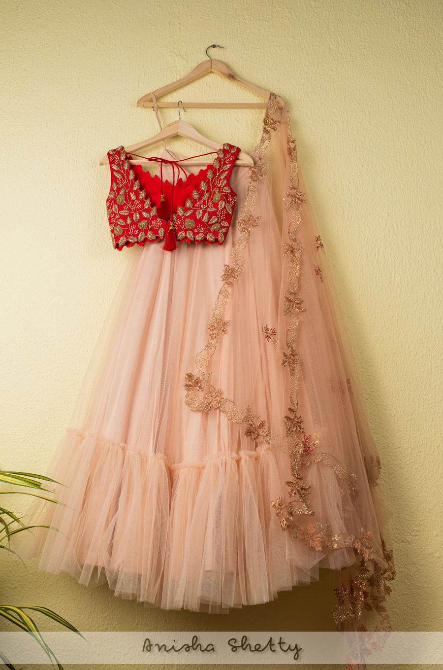SALMON PINK TIRERED LEHENGA WITH RED CUTWORK ZARDOSI BLOUSE AND ZARDOSI DUPATTA