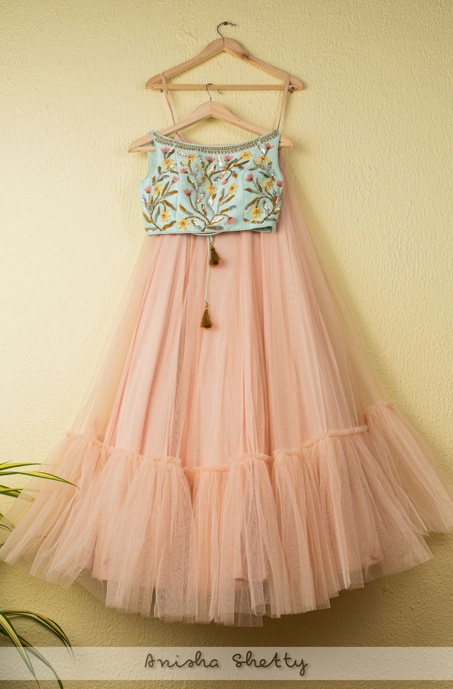 SALMON PINK TIERED LEHENGA WITH BLUE EMBOIDERED CROPTOP