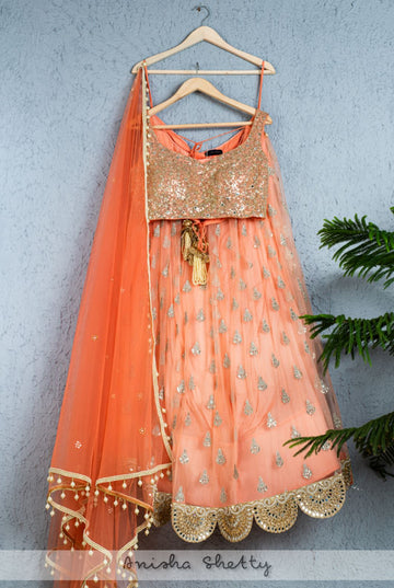 PEACH BUTTI LEHENGA WITH MIRROR & SEQUENCE BLOUSE & CORAL DUPATTA
